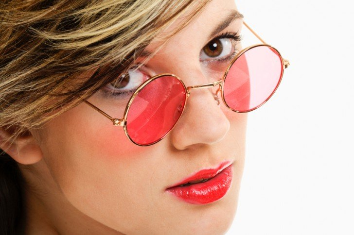 Young woman with rose tinted glasses