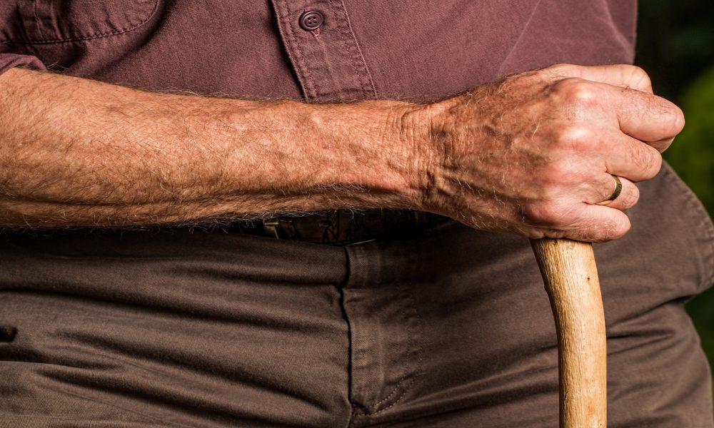 old man holding cane