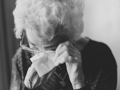 old woman senior crying retirement