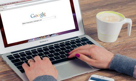 google laptop hands typing using computer