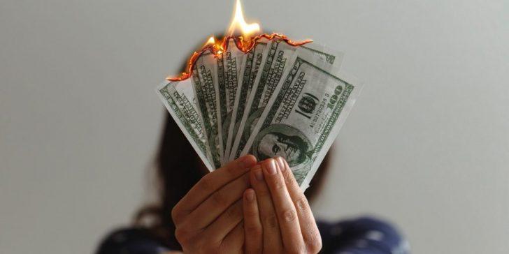 burning money cash dollars