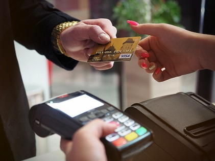 photo-of-person-handing-card